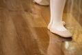 Ballet dancer feet on wooden floor Stock Photo