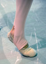 Ballet dancer foot with worn out shoes Royalty Free Stock Images