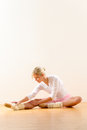 Ballet dancer in leaning posture exercise studio Stock Image