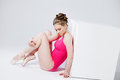 Ballet dancer, sitting on the floor in a pink Royalty Free Stock Photo