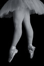 Ballet dancer standing on toes while dancing artistic converion Stock Images
