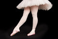 A ballet dancer standing on toes while dancing artistic conversi black background conversion Royalty Free Stock Images