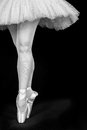A ballet dancer standing on toes while dancing black background artistic conversion Stock Image