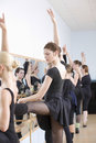 Ballet dancers practicing in studio beautiful young dancer with classmates Royalty Free Stock Image