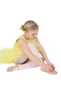 Ballet girl blond wearing a yellow tutu on white background Royalty Free Stock Photography