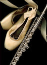 Ballet pointe shoes and flute. Royalty Free Stock Image