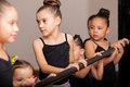 Ballet students paying attention cute little dancers standing next to a barre and to their teacher Royalty Free Stock Image