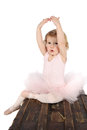 Ballet toddler little girl wearing a pink tutu on an antique trunk Stock Images