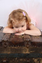 Ballet toddler little girl wearing a pink tutu on an antique trunk Royalty Free Stock Photography