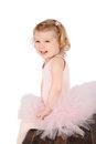 Ballet toddler little girl wearing a pink tutu on an antique trunk Stock Photography