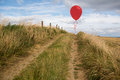 Balloon above sand dunes Stock Photo