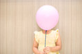 Balloon cover a girl take to her face Royalty Free Stock Photos