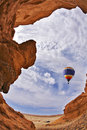 The balloon flies above a picturesque canyon Royalty Free Stock Photo