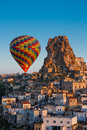 Balloon flight near the rock in turkish city of uchisar Stock Images