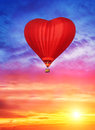 Balloon in the form of heart on the background of the sunset Stock Photo