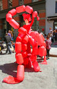 Balloon lady in red appears in tribeca family festival and street fair in greenwich ny Stock Photo