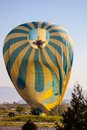 Balloon landing in cappadocia turkey one Royalty Free Stock Photos