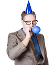 Balloon man end of financial year celebration geeky male business person blowing up blue during a work on white background Stock Images