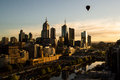 Balloon over melbourne hot air cbd at sunrise Stock Photos