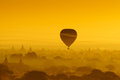Balloon over plain of Bagan in misty morning, Myanmar Royalty Free Stock Photo