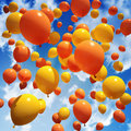 Balloon s released into the sky orange and yellow Stock Photo