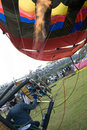 Balloonist operating burner Royalty Free Stock Photo
