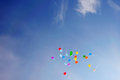 Balloons in a blue sky Stock Photos