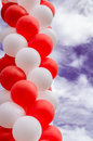 Balloons bunch of colorful on a background cloudy sky Stock Image