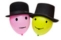 Balloons with eyes and mouth in a hats Royalty Free Stock Photography