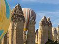Balloons and fairy chimneys flying between in a valley Stock Photography