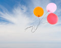 Balloons fly free over dramatic blue sky sea concept real and background Royalty Free Stock Photo