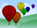 Balloons over hills rainbow colored hot air a simple landscape Royalty Free Stock Photography
