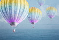 Balloons over watercolor sea landscape paper grunge background Royalty Free Stock Photo