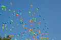 Balloons rising up into the sky Stock Image