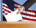 Ballot hand with and box on flag of usa Royalty Free Stock Photos
