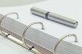 Ballpoint pen on notebook. office desktop detail. Royalty Free Stock Photo