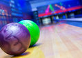 Balls on bowling alley against ten pins Royalty Free Stock Photos