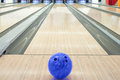 Balls on bowling alley against ten pins Royalty Free Stock Photo