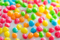 Balls of different colors on a white glaze.Background.