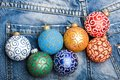 Balls with glitter and shimmering decorative ornaments. Christmas decorations concept. Pick colorful decorations. Modern