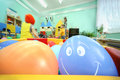 Balls lie in container; kids play Royalty Free Stock Photo