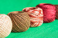 Balls of a multi colored yarn on a green background close up Royalty Free Stock Photography