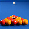 Balls on a pool table arranged in triangle blue baize Royalty Free Stock Photo