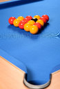 Balls set up on pool table blue with pocket in foreground Stock Photography