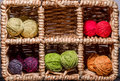 Balls of wool assortment many small rainbowcolors in wicker cells Stock Photo