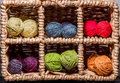 Balls of wool assortment many small rainbowcolors in wicker cells Stock Photos