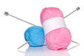 Balls of wool and knitting needles isolated on a white background Royalty Free Stock Photography