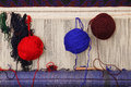 Balls of yarn on carpet loom Royalty Free Stock Photos