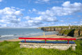 Ballybunion bench beach and castle view on a cliff edge with views of cliffs Stock Images