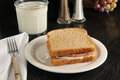 Baloney sandwich a on an old black table Royalty Free Stock Photos